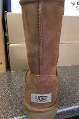 The UGG Australia logo on the back of a pair of Deckers Corporation boots.
