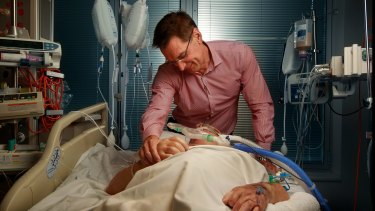 Dr Bill Silvester with a patient in Intensive Care at The Austin Hospital.