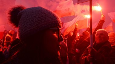A young woman at the far-right dominated demonstration in Warsaw.