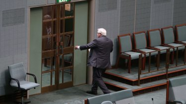 Clive Palmer leaves the chamber after his valedictory speech.