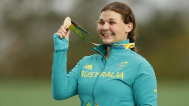 Catherine Skinner shows off her gold medal.