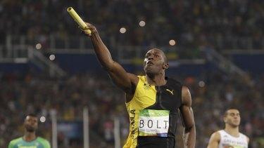 Simply the best: Usain Bolt celebrates after gold medal number nine.