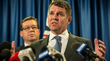 'I got it wrong': Premier Mike Baird with Deputy Premier Troy Grant at the press conference on Tuesday.