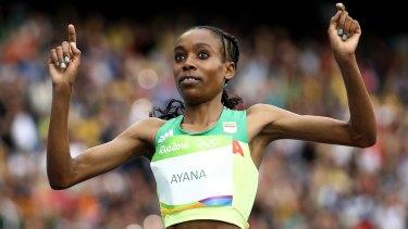 Almaz Ayana of Ethiopia crosses the finish line.
