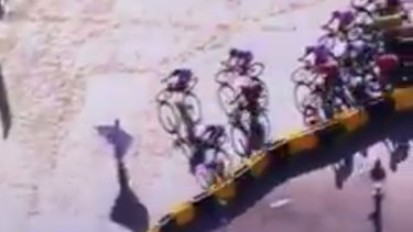 A protestor on the course in the final stages of the Tour de France.
