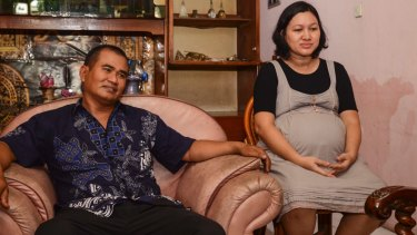 Traffic police officer Suhadi and his pregnant wife, Sri Rejeki.