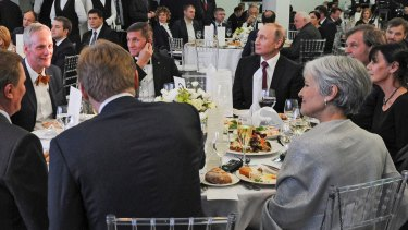 Michael Flynn (centre left) is seated next to Russian President Vladimir Putin at an event celebrating RT, the  government-backed Russian TV station.