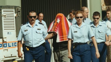Stephen James Boney is led by police to Moree Local Court after being charged with rape in April 2000.