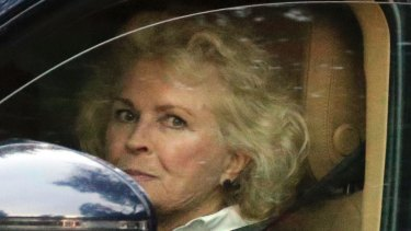 Sombre: Candace Bergen leaves the service.