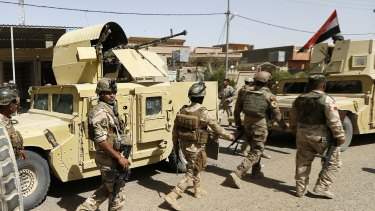 Iraqi security forces enter central Fallujah after fight against the Islamic State militants on Friday.