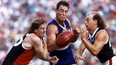 St Kilda's Michael Ford and Mick Dwyer contest ball with Footscray's Justin Charles in 1992.