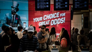 Ladbrokes sports betting agency advertising at Flinders Street station in 2015.