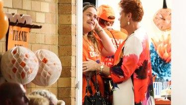 Senator Pauline Hanson consoles supporters.
