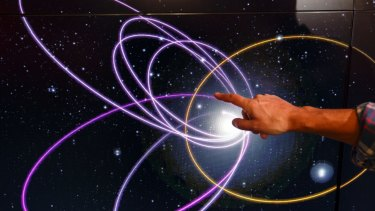 Mike Brown, professor of planetary astronomy at the California Institute of Technology, points to the gold ring showing a potential orbital path of planet nine in relation to the orbits of 'Trans-Neptunian Objects'.