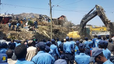 Police officers secure the perimeter at the scene of a rubbish landslide on the outskirts of Addis Ababa.