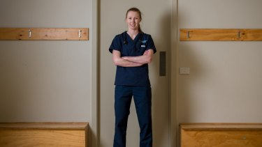 At work: Western Bulldogs player and doctor Tiarna Ernst in her hospital scrubs