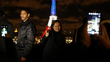 The Eiffel Tower lit up in the colours of the national flag for the second night in Paris on Tuesday.