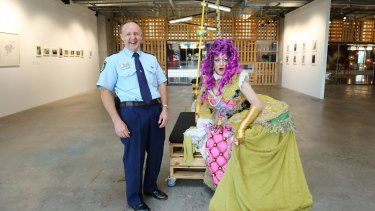 Superintendent Tony Crandell with Baroness Loquacious Fish in Sydney on Friday.