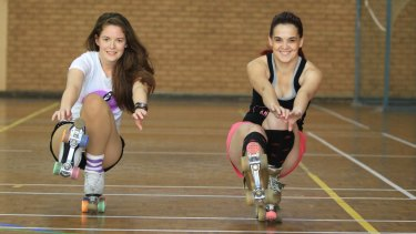 Stacey Short, left, and Yvette Colonna-Morrow perform exercises on rollerskates.