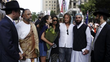 Tori Johnson's father, and sister (in blue) meeting religious leaders in Martin Place on Thursday.