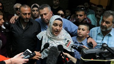 Mahmoud Hrouk's mother Maha Dunia speaks to the media outside the NSW Supreme Court on Friday.
