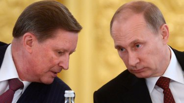 Russian President Vladimir Putin, right, listens to his now-demoted chief of staff Sergei Ivanov during a meeting in the Kremlin in Moscow, Russia.