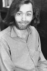 Charles Manson sticks his tongue out at photographers as he appears in a Californian courtroom, charged with the slaying of musician Gary Hinmanon June 25, 1970.