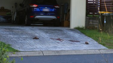 The horrific events left the driveway stained with blood.