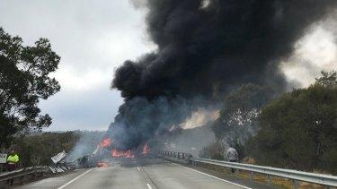 A truck on fire at the Wingecarribee Bridge at Berrima.
