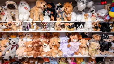 The stuffed toys are among friends in their neat shelves.