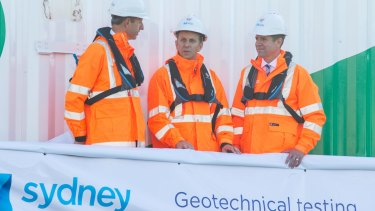 Sydney Metro project director Rodd Staples, left, with Mr Constance and Mr Baird on the Geotech barge.