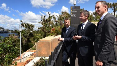 Transport Minister Andrew Constance (left), Premier Mike Baird and Sydney Metro boss Rodd Staples overlook the site for a new train station at Barangaroo.