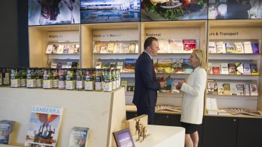 ACT Chief Minister Andrew Barr and the Federal Minister for Local Government and Territories, Fiona Nash, inside the new Canberra and Region Visitors Centre.