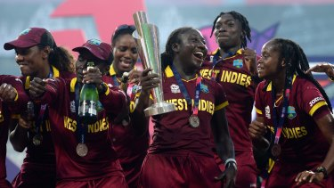 Celebration time: West Indies players with the World Twenty20 trophy after their upset final win over Australia.