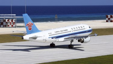 A China Southern Airlines jetliner lands at the airfield on Fiery Cross Reef, known as Yongshu Reef in Chinese, in the Spratly Islands.