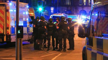 Police gather at the Manchester Arena in northern England