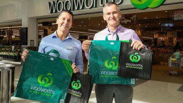 Woolworths Group chief executive Brad Banducci, right, and Woolworths Stores director Michael James with the company's new range of bags.