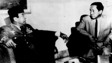 Indonesian Communist Party boss D.N. Aidit is received by Indonesian President Sukarno, left, at Jakarta's Merdeka Palace Thursday. Aidit sought help in arming peasants and workers to bolster national defence.