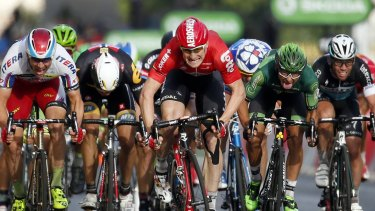 Lotto-Soudal rider Andre Greipel of Germany sprints to cross the finish line to win the final 21st stage of the 102nd Tour de France.
