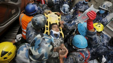 A 15-year-old boy has been plucked from the rubble five days after the massive earthquake.