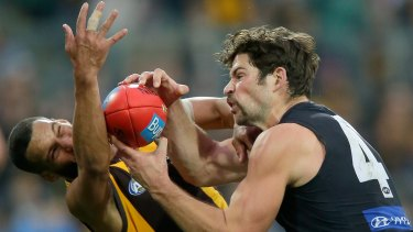 Josh Gibson of the Hawks attempts to spoil Levi Casboult.