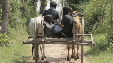 """In a scene from the film """"Camp 32"""", a family is transported to the countryside in an oxcart to be executed."""