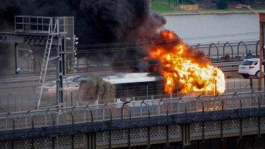 Fire engulfs the bus on the Sydney Harbour Bridge on Thursday night.