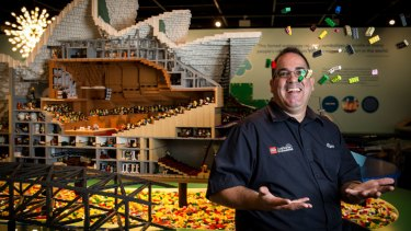 Ryan McNaught, Australia's only Certified Lego Professional, at his exhibition which features iconic Sydney Harbour buildings, at the Museum of Sydney.