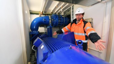 Ian Royston, from Melbourne Water, inspects the new ''mini-hydro'' plant at Dandenong North.