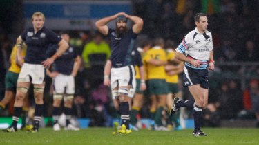 Quick exit: South African referee Craig Joubert runs off the field after blowing the final whistle.