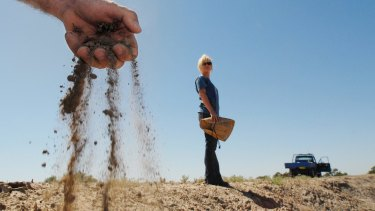 Brother and sister farmers Chris (left) and Claire Priestley on their drought-affected property near the outback town of Walgett, NSW.