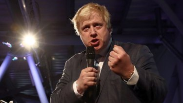 Conservative MP Boris Johnson talks to supporters during a Vote Leave rally.