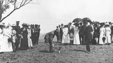 King O'Malley drives in the first peg in the development of the city of Canberra, 1913.