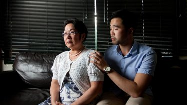 Hong Vo, mother of 22-year-old former Melbourne High student Martin Vo who took his own life last year, with her older son Daniel.